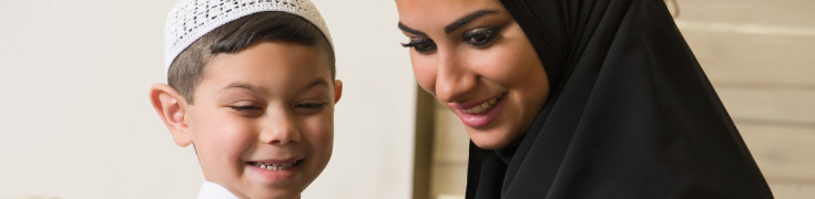 Smiling Arab mother and child